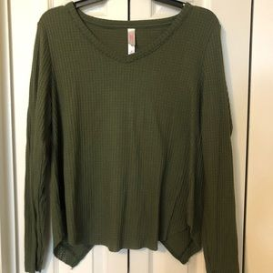 Green sweater with open back